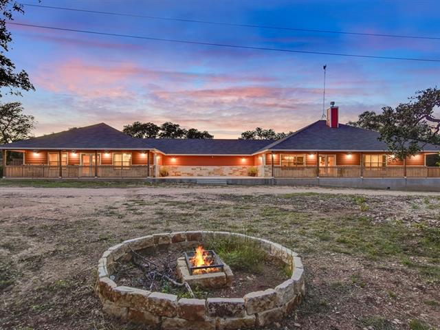 Rare opportunity in Bertram on 25+ acres! Conveniently located less than an hour away from Austin with easy access to major shopping in Cedar Park or Marble Falls. Come enjoy country living at it's finest on this prestigious layout. The main living quarter offers an open concept, floor-to-ceiling stone fireplace, 3 bdrms, 2 bath & an extra flex space/office. The second living quarter also offers an open concept, 2 great size bdrms and 2 bath. Both homes are combined by 600 sqft courtyard and wood deck.