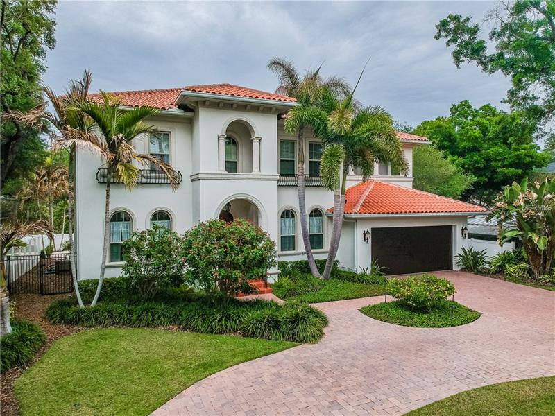 Luxurious custom build home in beautiful beach park neighborhood of South Tampa.  Close to shopping, dining, airport, & #1 rated beach in the USA.  Zoned in the highly sought after Plant school district.  This gorgeous mediterranean style home offers 5126sqft, 5 Beds / 51/2 Baths, spacious floorpan with high ceilings, custom archways & windows, quality construction from top to bottom.  Beautiful Brazilian cherry wood floors throughout.  The family room & gourmet kitchen is a wonderful space to enjoy gatherings. To really enhance that Florida lifestyle this beauty includes a full outdoor kitchen with covered lanai overlooking its tranquil luminesce pool for all to enjoy.  The 1st floor offers the family room, kitchen, formal dining room, living room, half bath, & large bedroom with full bath. Upstairs you will find the oversized master suite & 3 large bedrooms all with full baths. The oversized master suite has an additional space used for sitting or office.  The large master bath offer dual sinks, whirlpool tub, and a grand his and her walk in closet you will love!  Additional touches include luminous landscape lighting, paved circular driveway, mosquito nix system, and endless amounts of storage space. This is a must see!!