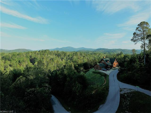 VIEWS: Wonderful potential. Great location between Lake Lure and Hendersonville. This small gated sub division gives you location, privacy, 8-acre communal area, trails along with a nice screened picnic building. The lot photos have been shot with a drone at 8'-24' above the building pad area to show possible views with some clearing. Lot is subject to a community pending assessment up to $15,000 per owner. Buyer to pay. Price has been reduced to offset.