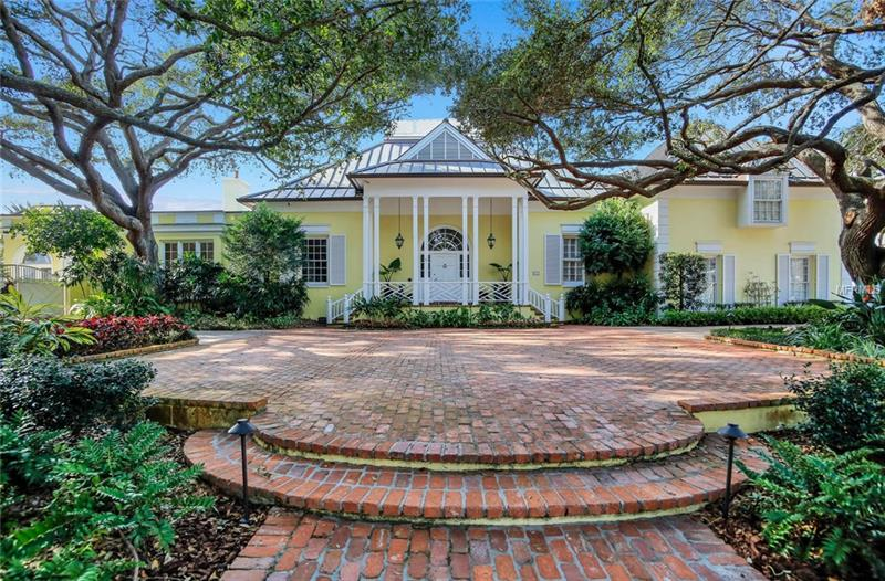 A true master piece in design.  A picture, perfect property in the Culbreath Isles community in South Tampa. It has easy access to St Pete and Clearwater, all Pinellas beaches, Tampa schools, International shopping mall, churches, International airport, downtown Tampa and only 1 ½ hours to Disney.  This beautiful Colonial Bermuda style home sits on a lot and ½ of open bay and canal a corner lot. This beautiful home is spread over the entire property with yacht protection on the grand canal.  The formal garden with fountain and an orchid greenhouse is lush when flowers and foliage are in bloom. As you enter the main house one walks into an elegant foyer with high ceilings, over 12', and staircase leading to magnificent living room with printed high ceiling walks into an elegant foyer with high ceilings, over 12', and a staircase leading to very 12'with magnificent living room with printed high ceiling and palladium arched windows overlooking Tampa Bay and sunsets all year around.  The arched molded doorways and built in shell arched cabinets, the fireplace, all give this room an elegant warmth.  The separate dining room with fireplace, palladium arched Bayfront windows and beautiful molding is very intimate for formal dining.  The kitchen is not just a kitchen, it is hexagon granite limestone and cream wood designed with double high ceilings looking to a large and bright glass sky light.  There is a magnificent built in colorful gourmet gas encased cook top with cabinet and hood. See supplement  attached.