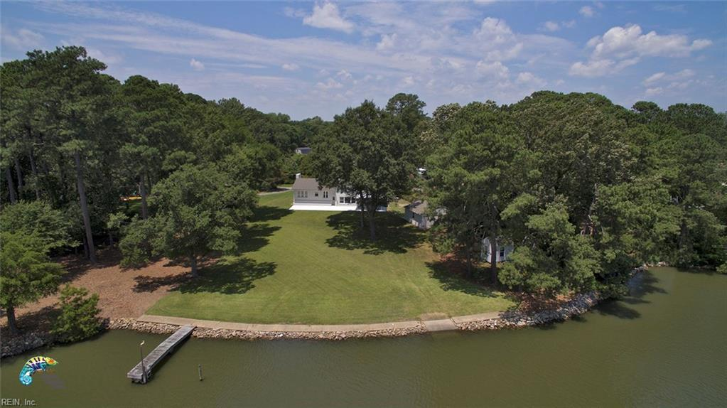 LIFE ON THE WATER IS BETTER! This unique, private cul-de-sac property is 1+ acre w/ 315 ft. on the water! Deep water, newly dredged channel, minutes from the bay. Dock & boat ramp. No flood insurance. Home designed to allow water views from Master BR, 2nd BR or office, Kitchen, Breakfast, DR, FR, Screened Porch w/ Clear view screen & Large 21 x 14 Balcony! FULLY REMODELED! 3.5 baths tiled w/granite. Feels more spacious than its 3700 sq. ft. w/5 bedrooms,or4 & office. Masters Up and Down w/baths! Laminate flooring in Master & Kitchen. Open modern Kitchen w/Island, plenty of cabinets & counters, great for entertaining! 1 wood & 1 gas fireplace. Huge finished basement/shelter has 16 inch thick concrete walls & ceiling, make it a gym, playroom or getaway. 2 car attached garage AND a 612 sq. ft. detached garage, plus 8x12 shed/clubhouse all w/ electric. New Driveway w/ extra parking and new 15 ft. x 50 ft. patio w/ custom 28 ft. bench facing the water, great for gatherings or just relaxing!