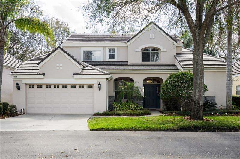 This is the one you've been waiting for! Recently updated and is the best value in this prestigous guard-gated community. Mature well kept landscaping line the streets as you drive home. Step through the front door in to the open layout...high ceilings make the home very elegant, wood/tile floors, and separate formal living/dining areas. The gorgeous 2-way wood burning fireplace is seen from both the formal living and family room. All new kitchen cabinets, granite countertops, and stainless steel appliances. The master bedroom is conveniently downstairs with his and hers walk-in closets and sinks. 2-unit split system A/C is only 2 years old! See Virtual Tour and Call Today,. 1yr Home Warranty included!