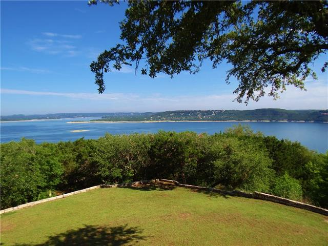 Own a piece of heaven. If using for a weekend home, it has 5 different sleeping areas, sleeping 14. This beautiful estate is situated on a gorgeous tree-filled acre lot overlooking Lake Travis*exquisite landscaping and breathtaking views are memorizing*Wall of windows embraces the views and creates a warm welcome. Renovated kitchen and bathrooms