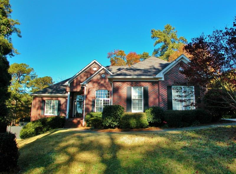 Hard to find fantastic brick ranch on a full basement! Convenient city location close to both the country club and Lake Lanier, and downtown Gainesville. 3/2.5 w/a split bedroom floor plan, soaring ceilings, built-ins, sunroom/family room and deck. Great level backyard that is completely fenced, large unfinished basement. So much space! This is a must see!