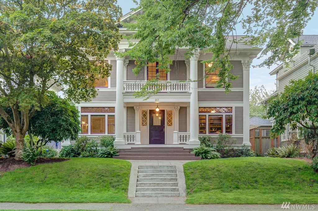 Welcome to the Jewel of Capitol Hill, an ornate, historically significant Greek Revival style home designed by J. Harry Randall for Dr. Adolph Loe in 1902.  Impressive two-story portico w/Corinthian columns, gleaming hardwoods with walnut ribbon inlays, wonderfully detailed Classical entry and impressive living room w/large formal dining room w/fireplace. Family room &  gourmet kitchen w/French doors that open to backyard & garden. Upstairs 4BR/2BA w/big porch off upper family area. Beautiful!