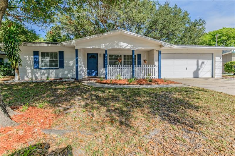 In The Heart of Dunedin! Wonderful split plan 3 bed, 2 bath, 2 car garage home with a HUGE, Fully Fenced in backyard, with plenty of room for a pool.  This spacious home features tile throughout, a Brand NEW Roof 12/17, NEW AC 2014, NEWER Triple Pane Windows, NEW Water Heater 2015 and Freshly Painted Inside which makes this house truly Move in Ready! Enjoy The Florida Lifestyle. Walking distance to Highlander Park and Hammock Park, located minutes from Downtown Dunedin, Pinellas Trail, Caladesi State Park,  Honeymoon Island, Some of the top Beaches, Restaurants, Shopping and Great schools. Call for your showing today!