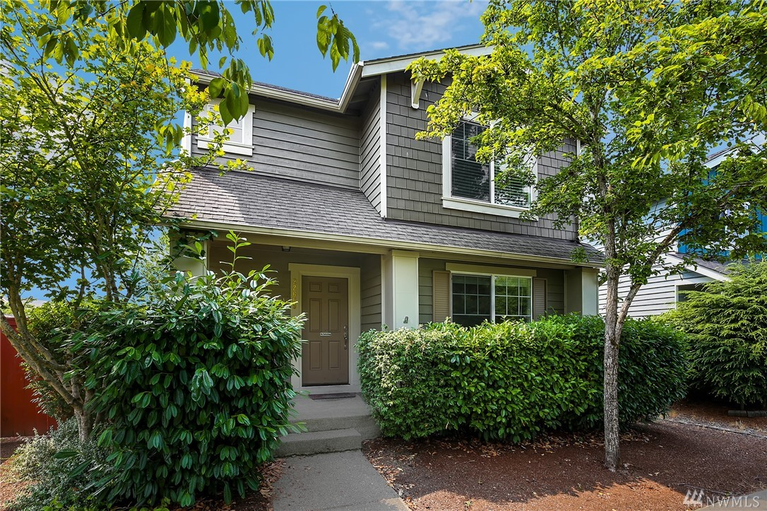 Delight in this 3 Bed 2.5 Bath, 1,480 sq. ft. home in highly sought after Redmond Ridge - walking distance to Rosa Parks Elementary. Spacious kitchen w/ S/S appliances, eating bar & extra large eating area. Master suite offers en-suite bath and walk-in closet. Home features AC and wood flooring throughout main. Enjoy privacy on the extensive backyard deck, level grass area & fully fenced. Quiet tree lined location with nearby parks, Redmond Ridge amenities, NEW middle school & metro park & ride.