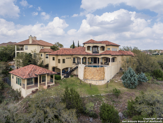 Absolutely stunning Stadler custom home in the guarded neighborhood, Summerglen. Step through the gated courtyard and inside for soaring ceilings, custom wrought iron railings and light fixtures, and numerous luxurious custom details. Casita has the 5th bedroom plus full kitchen and living areas on the 1.17 acre property. The home amazes with panoramic views in backyard from a relaxing Keith Zars infinity pool with full outdoor kitchen. Countless details of absolute luxury make this-your new dream home.