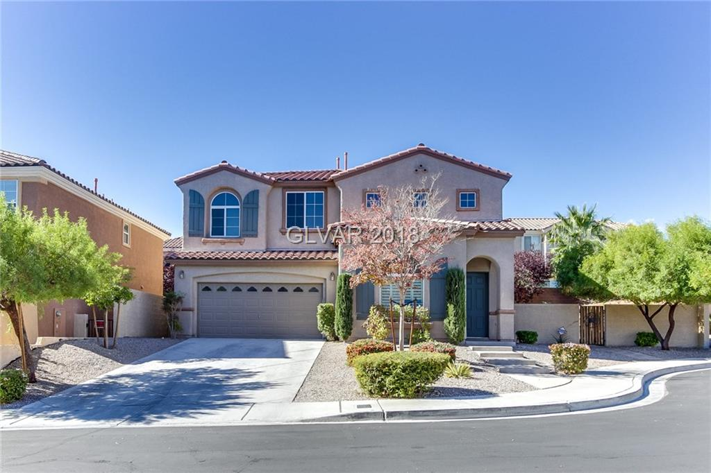 Built in 2005, this Las Vegas two-story offers a fireplace, a kitchen island breakfast bar, and a two-car garage. Upgraded features include fresh interior paint. This home is part of the Summerlin West HOA. Home comes with a 30-day buyback guarantee. Terms and conditions apply.