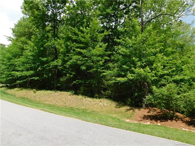 Great opportunity to get a lot on the 18th fairway of the #1 rated year round golf course in WNC! This lot is in Champion Hills, a Tom Fazio designed golf course only minutes from downtown Hendersonville shops and restaurants. This lot is close to the clubhouse. Come see where you are building your new home in this wonderful community!