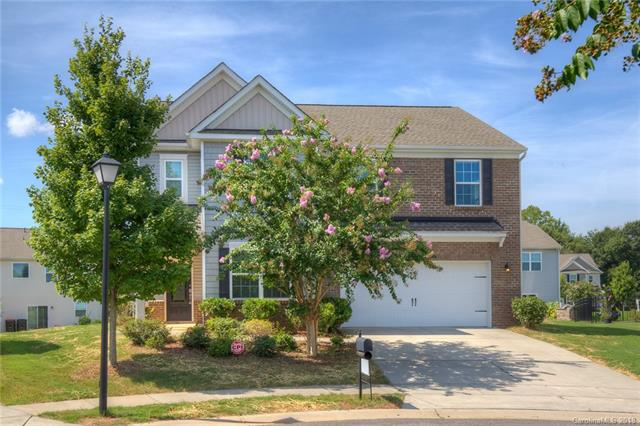 shows like a model home! Open plan w/spacious kitchen w cabinets galore+walk-in pantry, stainless  appliances, granite,tile back splash, expansive island/breakfast bar. . 2nd floor opens to enormous bonus room. Large master bedroom & bath w walk in closet.one of the few flat back yard at Carolina village.  You definitely don't want to miss this one! Super convenient location minutes from great shopping, dining, & access to I-485.