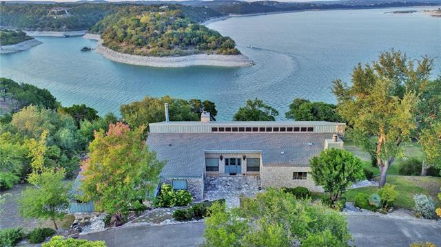 Lake Travis waterfront living at it's best! Your gorgeous property has over 345 feet of deep main channel waterfront (never dry), LARGE covered porches to enjoy the postcard like panoramic views, 2 slip covered boat dock with cement deck, Sprawling 2 Acre tree covered property consisting of 3 separate lots. A rare property that's been loved and cared for by an original resident. This well priced opportunity presents many options.  Personalize, update, rebuild or just move in and enjoy! (move in ready).