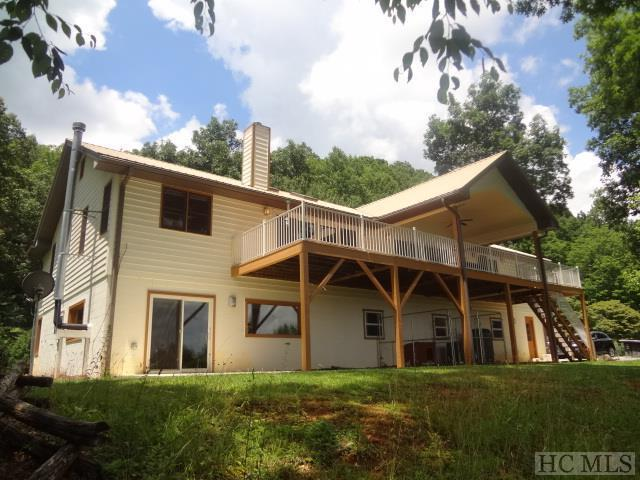 This Premier Property only 10 minutes to town is now available! Historic Significance goes way back with the original Log Cabin and Barn still in place. Outstanding Private, Unrestricted 28.23 Prime Acres of Pasture and Gently Rolling beauty. Bring your Horses, Cattle, Goats, Mules, Chickens. 10-12 +/- Acres of Fenced Pasture, Stream, Fenced Orchard w/Apple, Pear & Cherry Trees. Structures include 2 Stall Barn, Potting Shed, Tractor/Equipment Building, 2 Storage Sheds. BREATHTAKING Long Range 180 degree Mountain Views! Outdoor Living Space w/Vaulted Covered Porch & Expansive Decks. Main Level is Open w/Vaulted Living, Dining & Kitchen Areas. Big Glass Doors & Windows let the Incredible Views & Natural Light fill this home! Major redo in 2005 includes Hardwood & Tile Flooring, Kitchen w/Corian Counters, Cabinets, Island, Baths updated, Lighting, Fireplace, Finished Lower Level w/2 Sleeping Rms, Family Rm, Kitchen, Bath. Impeccably maintained --- no detail left out. Low, Low Power Bills w/$30,500 Solar Energy System installed 2015. New Generator 2017, Main Level Heat Pump 2016, New Well 2015, Metal Roof w/Skylights 2011. List of upgrades available. Move in Ready!