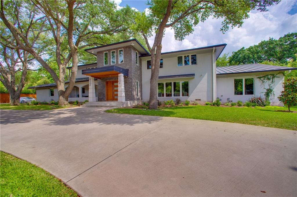 Spectacular 4-bedroom, 5.5-bathroom soft contemporary home situated behind a private gated driveway on nearly 1-acre of natural beauty in the heart of Preston Hollow. Perfect for today's modern style of living, this house has clean lines, an open floor plan and panoramic windows letting in an abundance of natural light. Artful use of quartz, chrome, and hardwoods create a distinct sense of luxury. This home boasts a two-story foyer, double-sided fireplace, lighted staircase, library, oversized master suite, spa shower, heated bathroom floors, Wolf-Sub Zero appliances, waterfall island, and large gourmet kitchen open to indoor and outdoor living areas (perfect for entertaining). A one-of-a-kind masterpiece.