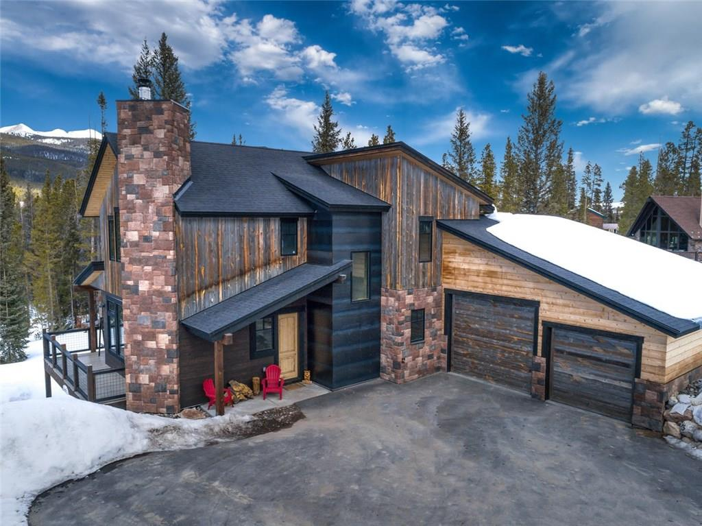 Outstanding home on an Outstanding Lot! Spectacular sweeping views of the Breckenridge Ski Area and the Ten Mile Range. Backs up to National Forest! This beautiful new home has all the high end finishes you could ask for! Tons of storage in 1000+ sqft heated 2 car garage and a paved driveway. Enjoy privacy on this quiet street and walk to the abundance of trails in your back yard including the Peaks Trail and Siberian Loop for hiking, biking and nordic skiing. This home sells itself!
