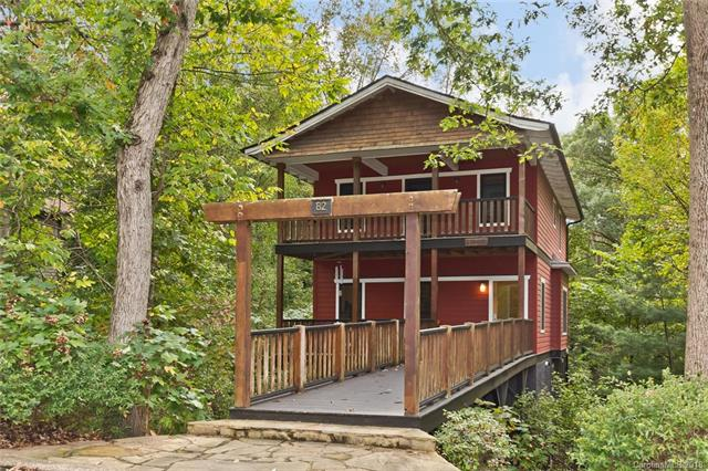 "The ""Montford Treehouse"" is a low maintenance green construction/healthy built gem among the trees and historic homes of walkable Montford.  Three stories of living space plus 760 sq ft of decking over three front porches and a cantilevered deck makes this home perfect for indoor/outdoor living.  This property will appeal to the environmentally conscious buyer, as the home's steel frame and pier construction is strong, stable, non-combustible, and impervious to termites and mold.  The addition of an interior door in the lower level would make this home perfect for short-term homestay rentals, as it has its own front entrance.  Designer touches include stainless steel kitchen counters; unique stone and wood kitchen island; natural maple sheet panel walls in lower level; tray ceilings; craftsman window and wall framing; an open and light-filled stairwell; upper master with private deck & barn door to bath.  This unique home tucked away among the trees defines the best of WNC living!"