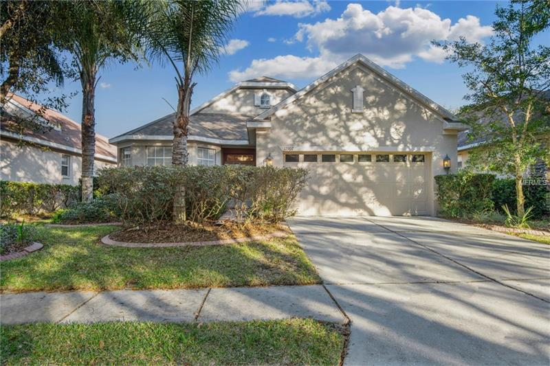 This impeccable home is located in the highly sought after community of Arbor Greene in New Tampa. It is a 3/2 bath, approximately 2,055 SF home situated in the village of Parkview, and secured by a front 24 hour manned gate and an interior automated gate. This great open floorplan has everything you need.  A separate office in the front of the home, a full-size dining room, and a beautiful wrap around, paver, screened lanai overlooking conservation make this home feel so much larger.  The Arbor Greene community offers two pools, tennis courts, a fitness center, and a beautiful clubhouse. Bike to the nearby library, grade school, or middle school.  Only minutes to two incredible upscale shopping malls, easy access to major roads, hospitals, and the USF campus. This is Florida living at its best and is centrally located in the heart of New Tampa!