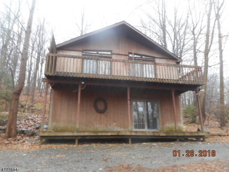 Enjoy peace and tranquility amongst trees and wild life in this chalet styled raised ranch. Nice sized rooms, open LR-DR-Kitchen area. Master BR with en-suite bath Family room in lower level has plumbing for an additional bath