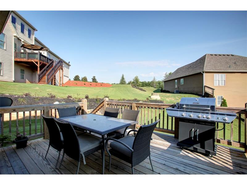 Oversized deck with only a few steps to the beautiful backyard!