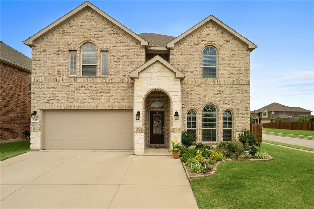 Stunning 2 story home is situated on a large corner lot in Valor Pointe! Prosper ISD! Beautiful brick & stone elevation! Formal Dining, Archways, Neutral Paint, Fabulous Kitchen w-granite, stone back-splash, SS apps, dark cabinetry + a raised breakfast bar! Breakfast Nook overlooks the Sunny Living Room w-a cast stone fireplace! Light & Bright! Sprawling Master Suite is generously sized w-a sitting area & an attached bath that has a separate shower, garden tub + dual sinks! Upstairs you will find a MASSIVE Game Room that was designed for entertaining + 3 spacious guest bedrooms & 2 full baths! Full size utility w-built in cabs! Over-sized Backyard is very large & features a covered patio! MOVE IN READY!