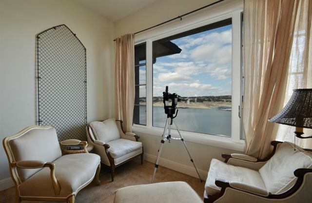 Luxury waterfront condo on Lake Travis with panoramic views.  Condo boasts large living area with enough space for two seating areas, a spiral staircase to an enclosed loft *which owners use as a 4th bedroom*, hard tile through-out, window treatments, stainless steel appliances and other elegant features. Residents have access to the Lakeway Resort and Spa including swimming pools, fitness center, and dining facilities.  Also available for lease! Lake Travis ISD.