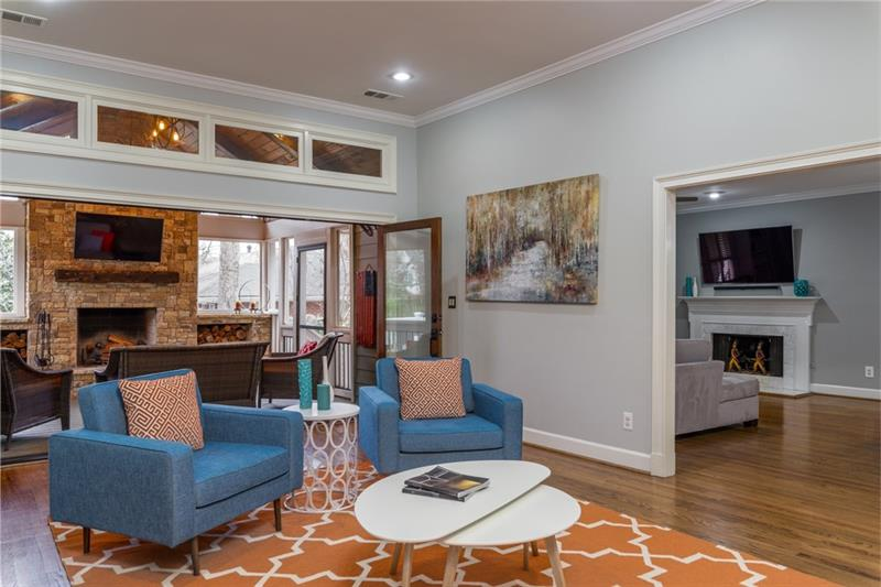 Sitting room can be used for add'l space when accordion doors are open to screened-in porch!