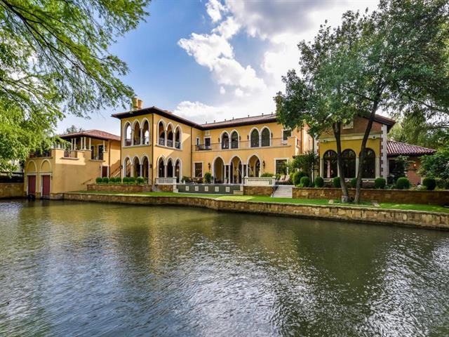 This magnificent estate inspired by the historic Venetian villas that line the Grand Canal was exquisitely crafted along nearly two hundred feet of Lake Austin waterfront. The meticulously maintained grounds of this property are set on a premium half-acre lot in the prestigious waterfront community, the Island at Mt Bonnell Shores. The home offers opulent Austin living, luxurious pool & outdoor terraces, two enclosed boat slips, guest quarters.. all fit for an Italian aristocrat!