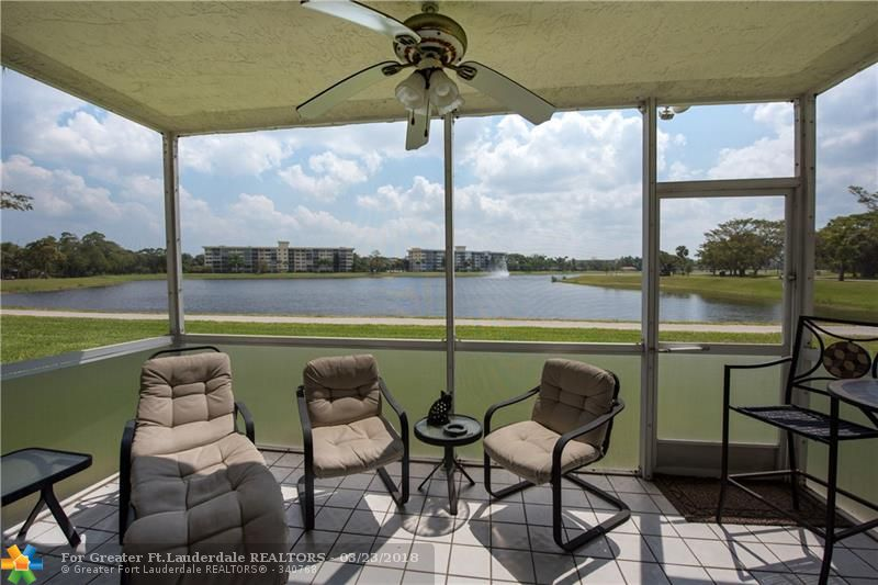 """SPECTACULAR EXPANSIVE LAKE VIEW! TOTALLY TURN-KEY. EXTREMELY WELL-MAINTAINED UNIT.  THIS SPACIOUS 3 BED, 2.5 BATH FEATURES BEAUTIFUL KITCHEN WITH GREAT CABINETS & GRANITE COUNTERS, UPDATED GUEST BATHROOM, SPLIT FLOOR PLAN, WASHER/DRYER, ACCORDION IMPACT SHUTTERS, RECENTLY PAINTED IN NEUTRAL COLORS, LOW MAINTENANCE.  ONLY BLDG IN ASSOC.  PALM-AIRE IS SURROUNDED BY 3 MAJOR GOLF COURSES & COMMUNITY PARK, PUBLIX, I-95 & FL TRNPK, RESTAURANTS, SHOPPING, CASINO & 6 MI FROM BEACH. """"AS-IS"""" W/RIGHT TO INSPECT."""