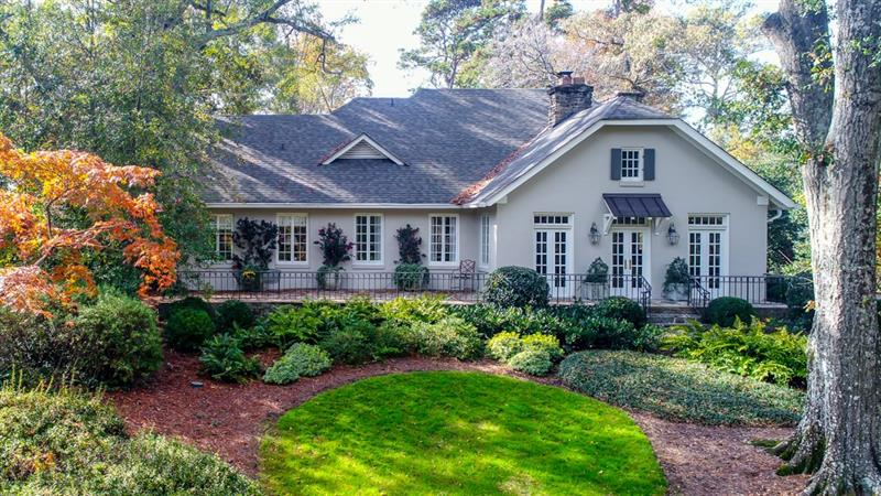One of Historic Brookhaven's most charming homes on its loveliest street, all on .8 +/- acre lot. Relax in the vaulted ceiling Great room w/its massive stone fireplace or the expansive Family room w/its beamed ceiling & fireplace you will love this home. It features a walkout back yard with pool & Guesthouse/Pool house, a main level bedroom and bath, a gracious light filled dining room, a cozy keeping room and open kitchen. The upper level features a lovely Master with balcony and a new luxurious Master spa bath plus 2 additional bedrooms & bath.
