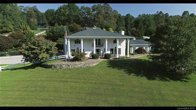 Iconic Wilson Farm colonial! Rocking chair front porch. Formal living and central dining are grand entertaining spaces. Wood beams,raised fireplace and custom cherry cabinets make the spacious family room cozy. Remodeled gourmet kitchen features a breakfast area with a fireplace and storage galore. Coffee bar with custom cabinetry leads to the main floor owners' suite with private bath. Flexible upstairs space. Lot features a stream,brick patio,fenced areas,and custom landscaping.Virtual Tour.