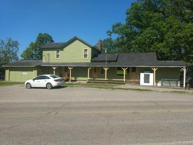 Great opportunity on Portage Lake next to the public beach which includes a 3 bedroom (non-conforming) rental overlooking the lake with 2-1/2 car attached garage on .41 acres.  Also includes convenience store with furnishings and commercial kitchen area.  Newer commercial septic & plumbing system.  Land lease for a new buyer in 2018 will be $366 per month. Great place to live and work with only a small investment to get the store back up and running. Surrounded by the Waterloo Recreation Area.  Also includes a shed. This could be your opportunity to be your own boss and live and work at the lake or you could just have a nice big lake home.  Low township taxes. Cash Only Sale; however, Flag Star may be able to lend on this property.