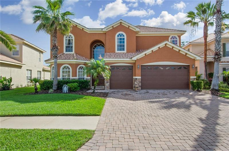 Magnificent Masterpiece! Situated on large gorgeous conservation lot in highly sought after man-gated community of Cory Lake Isles! Open floor plan with 3,944 sq ft of luxurious living space! This is the perfect place to call home! features 4 bedrooms, 5 bathrooms plus office/den & loft/bonus area, 3 car garage & Salt Water pool. Enter into the grand double door entryway with stunning porcelain tile. Formal living room & dining room. Beautiful large kitchen with granite countertops, mostly all new appliances, 42 inch cabinets with crown molding, center Island, butler pantry, breakfast bar & plenty of eat-in space. Kitchen opens up to family room with 24 ft ceilings & sliders to beautiful salt water pool with waterfall, covered & screened brick paved lanai. Enjoy the peace & tranquility of your own backyard! Gorgeous outdoor kitchen, great for entertaining! Master suite is located on first floor with his/hers vanity areas at master bath, 2 huge walk in closets, garden tub & separate beautifully tiled shower. 2nd floor boasts the rest of the bedrooms with there own bathrooms plus a desk area. Hurricane shutters, sidewalk along side of house, fresh paint inside & out. Gorgeous Belgium chandeliers worth over $50k, central vac, new a/c carrier & much more! Tons of community amenities, man made beach area, community club, fitness, pool, sports courts are just a few to mention. Close to I-75, Great shopping, dining & minutes from wiregrass & Outlet mall. This house has all the bells & whistles & a must see!