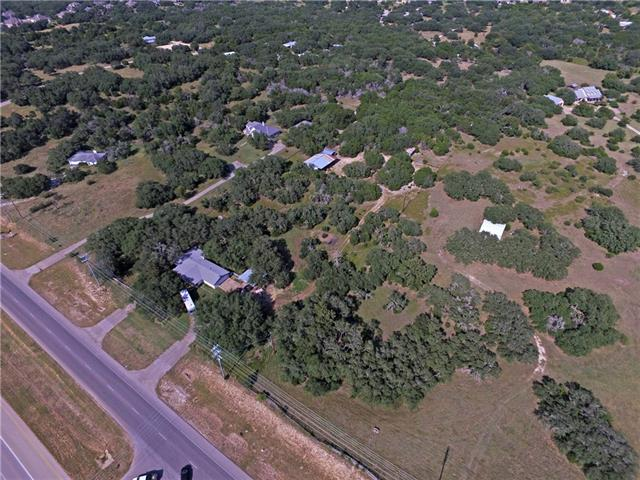 4 acres and 3 bedroom/2 bath home off Ronald Reagan.  This area is very desirable and growing.  This property has great commercial potential.  Already hooked up to City Water.  City sewer lines already at the street.  Current home is on septic.