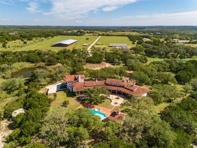 Luxurious Old World Equestrian Estate with Authentic Spanish Colonial Architecture on 38 acres in Dripping Springs Texas. The home boasts one of a kind unique imported hand carved solid stone block construction with detailed hand carved wood doors, trim and hand painted imported tiles and many other custom details. This gated ranch estate includes swimming pool, spa and outdoor entertaining cabana and professional lighted tennis court. Property includes multiple barns with 120' x 220' covered arena.