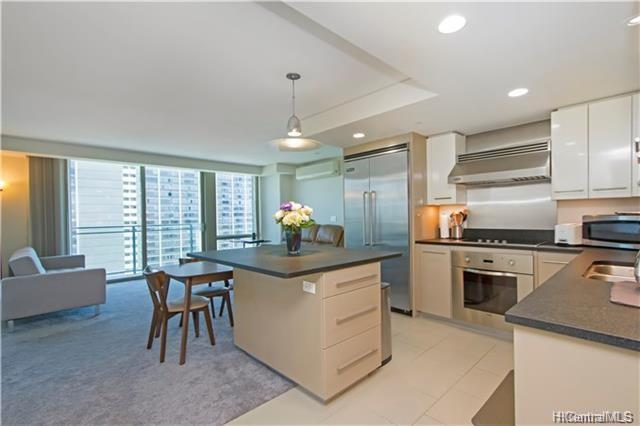 Desirable corner unit in Capitol Place with city and mountain views.  This 2-bedroom 2-bath unit has an open layout and bonus den area.  Features wrap around floor to ceiling windows gourmet kitchen with granite counter tops and Viking appliances.  Completely new split AC system throughout.  Relax on your lanai or enjoy the infinity edge pool, exercise room, BBQ, cabanas, dog park and theatre.  Comes with two parking stalls and storage.   An ideal location at the top of downtown Honolulu.