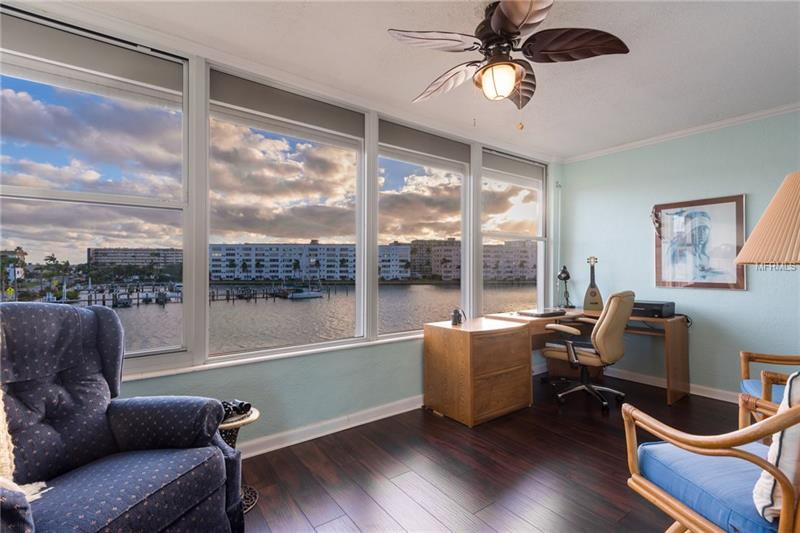This Spacious 2 Bedroom, 2 Bath Corner Unit Overlooks the Marina! Enjoy Beautiful Water Views & Watch the Dolphin Play from Your Coastal Florida Room! Interior Features Include Updated Lighting, Laminate Plank Flooring, Tons of Storage & Brand New A/C. The Updated and Open Kitchen Features Soft-Close Drawers & Cabinets, Granite Counter Tops, Natural Gas Stove & Pantry with Roll-Out Shelving. The Living Room Features Crown Molding & Ample Windows to Allow Plenty of Natural Light In! The Master Bedroom Suite Includes a Walk-In Closet & Private Bath with Tub/Shower Combination. Sip Coffee from the Florida Room & Watch as the Boats Come and Go! Covered Carport! Welcome to Town Shores! Voted Condominium Association of the Year 2017 by the Community Associations Institute Suncoast Chapter. This Popular 55+ Community is located on Boca Ciega Bay-Between Pasadena Golf Course & Gulfport Beach. Gulfport has been Featured on the Travel Channel as a Must See Town in America! The Clubhouse has an Arts & Crafts Room, Poker Room, Billiard Room, Game Room, Library, Conference Room, Exercise Room, His & Hers Saunas & More! The Beautifully Landscaped Grounds Include 4 Swimming Pools, Patio/Grilling Areas, Tennis, Pickle Ball, Bocce & Shuffleboard Courts. The Newly Renovated Marina Provides Slips for 40 Boats & Kayak Launch. Sitting Areas with water views & Gardens are Scattered Among the Community. There is Always Something to Do Here!  Convenient to Shopping, Beaches and I-275. No Pets. Lease Ok with 1 year Ownership.