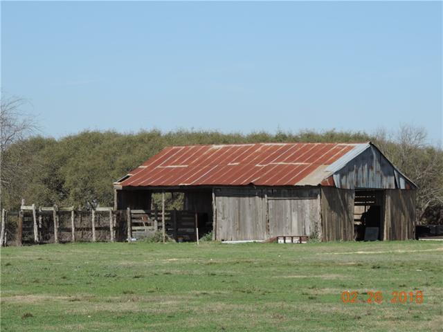 """Beautiful 10.30 acre tract #7 offers Original Homestead Barn """"Buyers choice to Renovate or Remove""""  Only 9 tracts available in """"The Ranches at Turkey Springs""""  Elaborate Custom Gates - Black top road - Canopy Shade Trees -private well - Not many Amazing lots available in Williamson Country this close to Georgetown.  Act FAST -"""