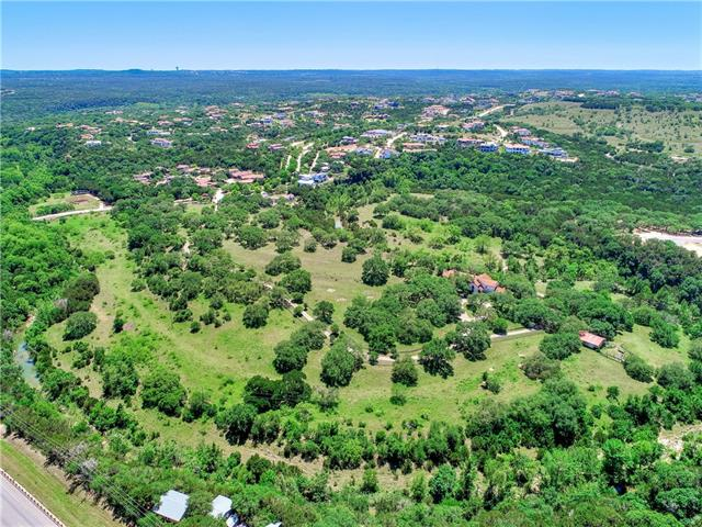 Rare opportunity to live on a 50-acre ranch located inside guarded gates of a prestigious neighborhood.  Complete privacy & seclusion within beautiful hill country terrain, rolling hills, native vegetation and stunning views. This is prime real estate. Little Barton Creek meanders through the property. Existing 6400 SF house & pool can be a remodel or tear down. Or build your own custom estate.  Hill country privacy & serenity yet all the conveniences of city living/grocery/shopping/Lake Travis schools.