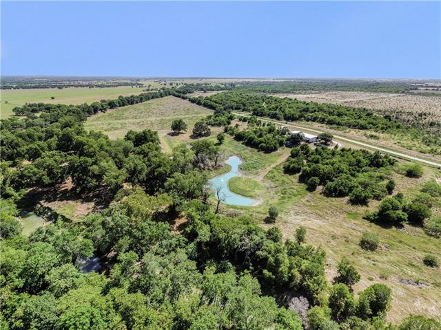 Own your own special piece of Texas sitting on the San Gabriel River! Located near historic Apache Pass this nearly 20 acres has several locations to build your dream home to overlook the beautiful pecan bottom or the stock tank with your very own island. 4000 sq ft metal building with reinforced concrete slab could be an excellent start on a barndominium or workshop/ warehouse. 8000 gallon water rain water harvesting system, water rights to the River and mineral rights as well. Possibilities are endless.