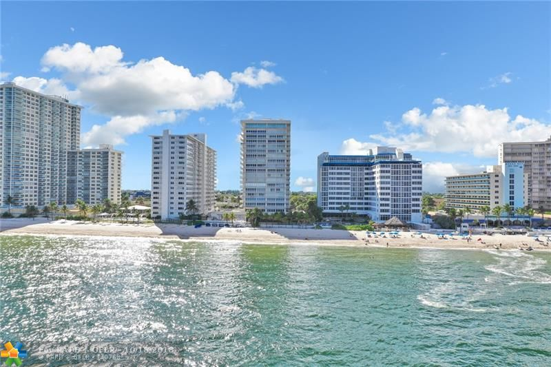 Spectacular 2 bed/2 bath direct oceanfront condo remodeled in 2018 with permits. Open floor plan features 24x24 porcelain tile throughout, smooth ceilings, new doors and trim. Master suite includes oversized bedroom/bathroom, walk-in closet and an extra 12x12 room that could be used as a den/office. Gourmet kitchen features all wood white shaker cabinetry, quartz countertops, stainless steel appliances and marble backsplash. All HVAC, plumbing and electrical replaced to 2018 building codes. Other items include a ventless all in one washer/dryer and huge freshly painted balcony. Resort style amenities include recently remodeled spa, fitness center, rooftop pool, clubroom and more. 1 covered parking space. Live steps from the ocean in this move-in ready condo.