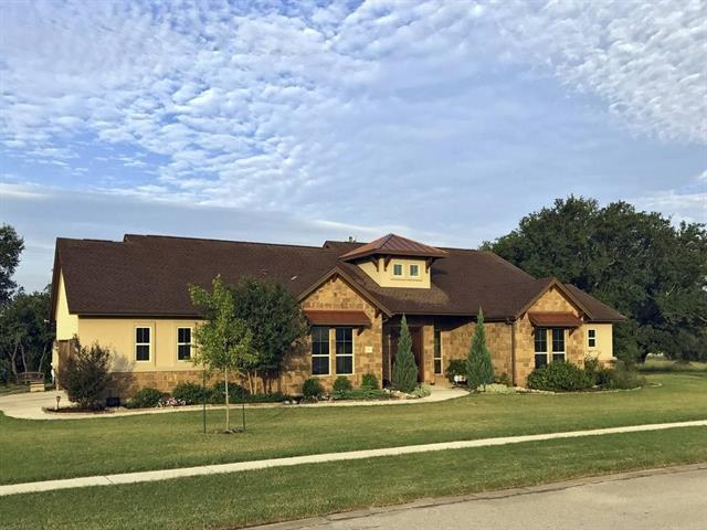 Drennan Day Custom Home!  4 beds plus an office.  Oversize 3 car garage with workshop area.  Large lot with ancient oaks and Hill Country views.  Open floor plan and neutral colors.  12' ceilings in great room, 10' everywhere else.  Crown molding throughout.  Stone fireplace and breakfast bar.  Two large pantries.  Many more custom features!  HOA park and pool with access to South San Gabriel river for fishing & kayaking.  Liberty Hill schools through open enrollment. Low Burnet Co. taxes!