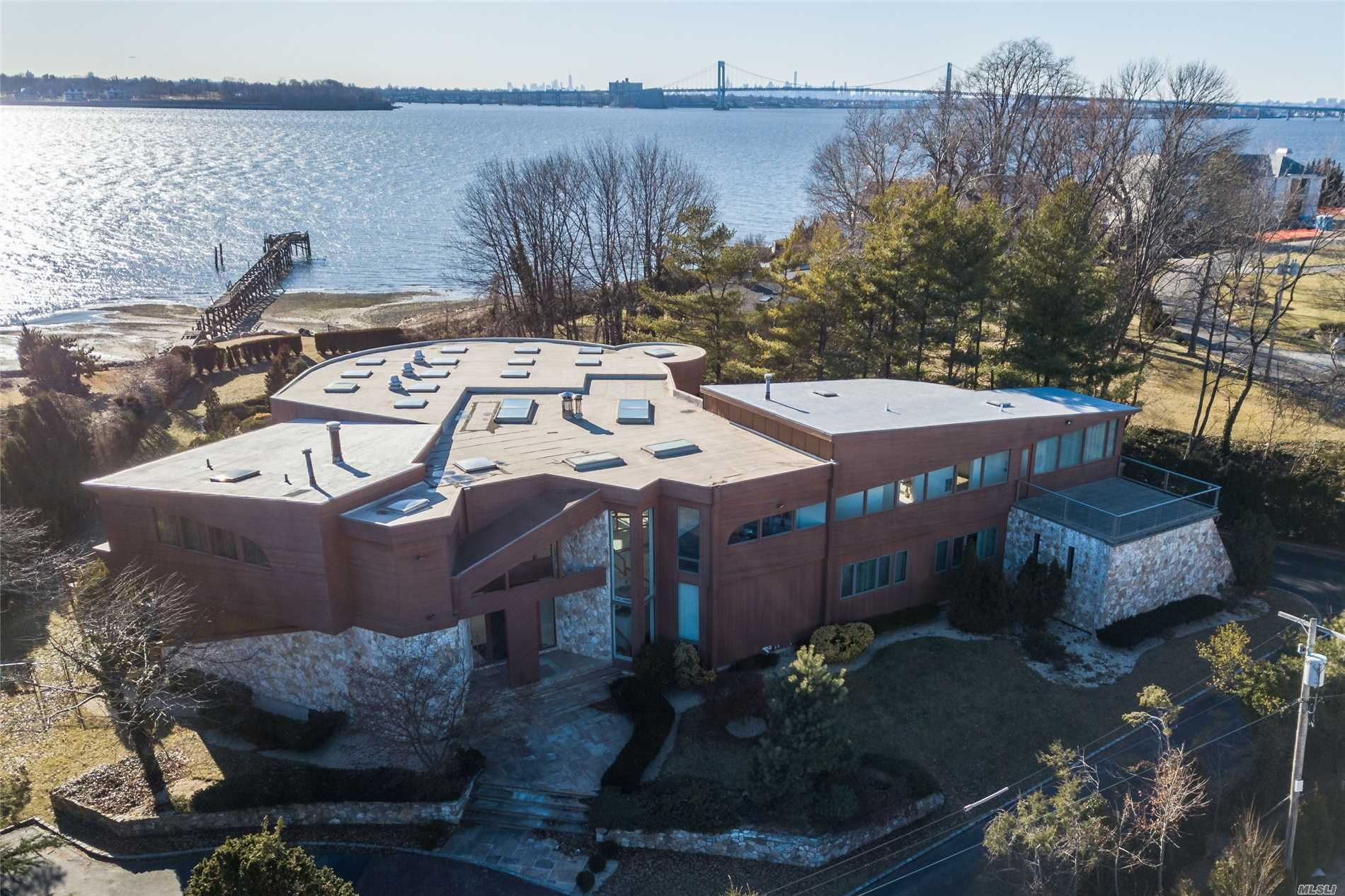 Stunning Waterfront Masterpiece With Breathtaking Views Of Manhattan Skyline & Bridges. Contemporary Boasting Spectacular Interiors, Soaring Ceilings, Indoor Pool And Wrap Around Floor To Ceiling Walls Of Glass Opening To Magnificent Resort Like Backyard With Man Made Lazy River Winding Through Japanese Gardens, Jaccuzi & Waterfall & Access To A Semi-Private Dock!