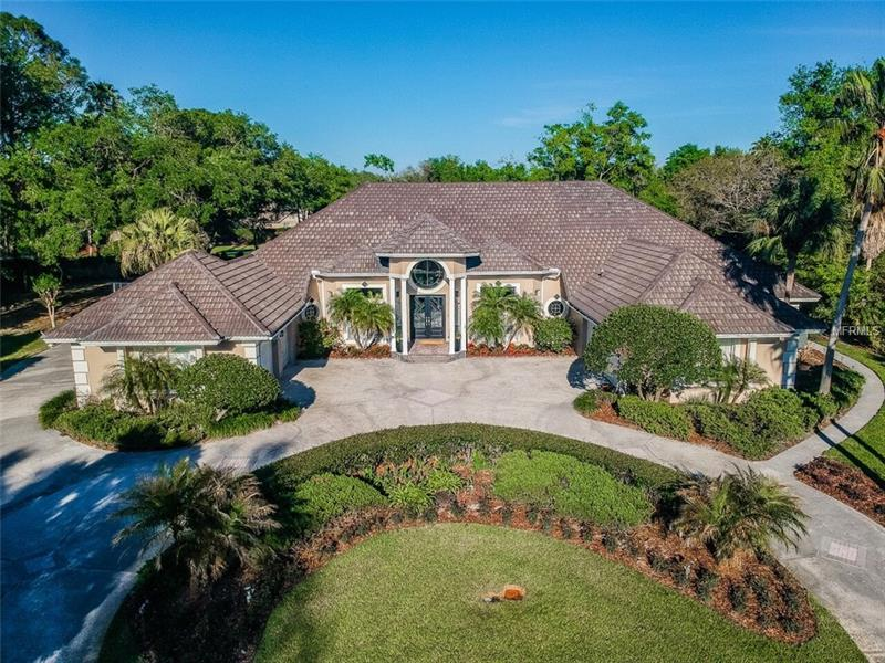Check out video walk through and 3D tour! 24-hour guard and gated luxury in the Reserve at Tampa Palms, one of the most highly respected communities Tampa Bay has to offer! Nearly 1 year to design with the in-laws in mind! Private entrance with full kitchen, sitting area, bedroom, and full bath! Harry Gray has built some of the most renowned estates for Tampa bay's most powerful and influential figures. This oversized pie shaped lot was specifically chosen with a family dream in mind! Plenty of space for basketball, football, trampolines, playground sets perfect for the young ones! This stunning floor plan offers 5,564 SF of beautifully crafted living space with a breathtaking grand entrance, sprawling 16+ vaulted ceilings with decorative columns, triple trey ceilings, corridor of closets around every turn! The craftsmanship and attention to detail in this estate is nothing but first class. After all, Harry Gray never builds the same property twice! Pictures only showcase a small taste what this lavish home has to offer!