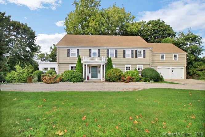 AMAZING PRICE REDUCTION! The grandeur of yesterday meets the amenities and cachet of today. This magnificent vintage colonial has circular driveway leading to grand entry hall and beautiful front staircase. Charming formal rooms with coffered LR ceiling, fireplace and bookshelves, banquet DR w/ beautiful millwork and French doors leading to sprawling deck, open kitchen/FR w/corian counters, SS appliances, wet bar, fireplace, vaulted ceiling w/beams and deck access. Charming first floor library w/mahogany panelling & hallway half bath. Sunroom has new windows. Rolling lawn & winter waterviews from the massive deck which spans the entire back of the house. Master suite has new marble bath, double sinks, dressing room, builtins and closets galore. Bedrooms 2 and 3 have Jack and Jill bath, BR 4 has ensuite bath. Two additional bedrooms and hall bath are accessed from both the upper level and rear staircase, perfect for au pair, in law or teenage suite. The third floor has been newly finished into a cathedral office/exercise room with a fifth full bath and knee wall closets. Huge recreation area on lower level with stone fireplace, a game room, separate laundry room and wine cellar. This home epitomizes grand living in intimate St Mary's Seaport setting where neighbors stroll along the water on the promenade, sail, and frequent Harborview Market for coffee and conversation. This is living at its best.