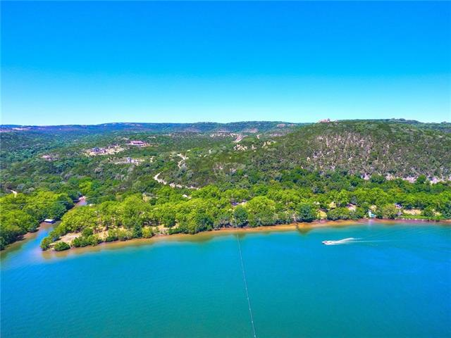 The Lake Austin Ranch is a rare 65.68 acre property located along the shores of Lake Austin near the 360 bridge. This iconic property features 2600 +/- ft of water frontage, an 8 slip marina and is only 6.5 miles NW of downtown Austin representing one of the last opportunities to own a large tract this close in. The property features gently sloping terrain covered in pecan, oaks & cypress with diverse plant and wildlife. incredible home site for 25,000 SF main house & much more