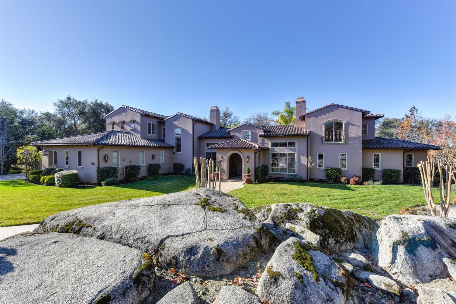 Gorgeous home in the highly sought-after community of the Boulders at Los Lagos, a small enclave of custom estates in the Loomis School District. This exquisitely designed home features handsome Savage cabinetry, top-of-the-line stainless steel appliances, boxed ceilings, plantation shutters, elegant fireplace surrounds and the list goes on. Open floor plan offers spacious rooms, en-suite bedrooms, 1st floor master retreat & storage galore. 1.7-acre lot has rock outcroppings, pool/spa & privacy.