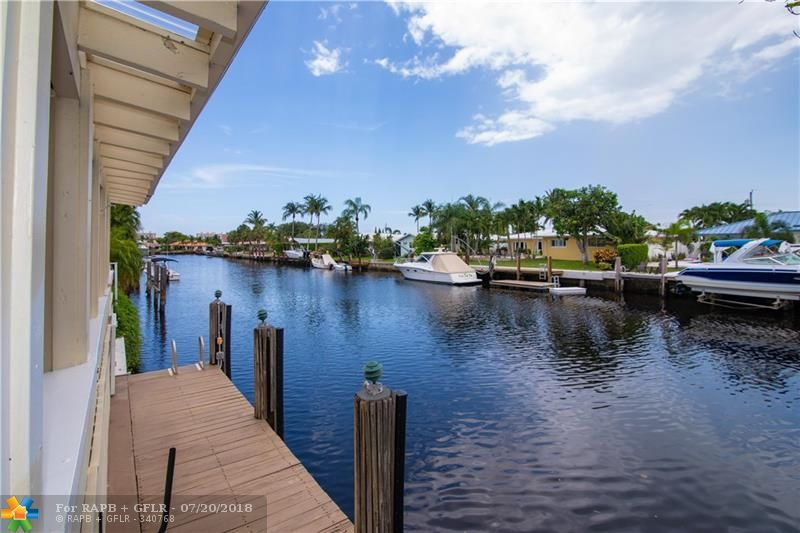 ELEGANT WATERFRONT HOME ON OVER SIZED CORNER LOT IN DESIRABLE LAKE ESTATES. THIS UNIQUE HOME OFFERS 4 BED 3.5 BATH MAIN HOUSE AND 2 BED 2 BATH IN-LAW QUARTERS WITH SEPARATE ENTRANCE. UPDATES INCLUDE OPEN KITCHEN, CROWN MOLDING, MARBLE & HARDWOOD FLOORS. SPACIOUS COVERED DECK WITH TRANQUIL WATER VIEWS & ROOM FOR A POOL! IN-LAW QUARTERS HAS OPEN LAYOUT WITH FULL KITCHEN, OPEN LIVING ROOM AND PRIVATE PATIO. PERFECT FOR LARGE FAMILY OR SAVVY BUYER THAT WANTS TO LIVE IN MAIN HOUSE AND RENT THE IN-LAW SUITE.