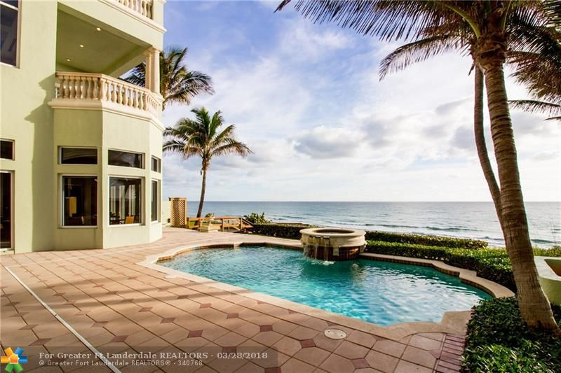 Enjoy breathtaking views of your private beach throughout your four-story home in the exclusive gated community, Ocean Place Estates, within the highly sought out town of Highland Beach. This home features a private pool and spa, classically elegant home theater, traditional library, marble floors throughout open and spacious floor plans, and two garages housing a total of 6 cars.