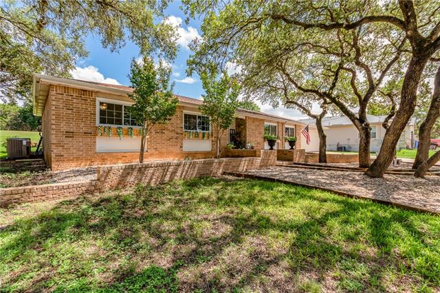 Gorgeous Oaks & Xeriscaped Yard,4-Sided Brick backs to #7 Hole on LV Golf Course. 3 bdrm/ 2bth W/ Office off Living. Tile & Laminate. Granite in kitchen, upgraded cabinets, plumbed for propane cooktop. New HVAC & heat pump; Double pane vinyl windows; Updated master bath W/2 M closets. Large laundry W/plenty of storage. Covered patio, Pergola for outdoor dining, fire pit. Minutes from Lake Travis, Community Fitness Center, Pool & Tennis Courts.