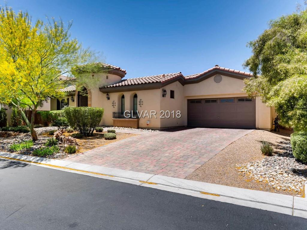 Mountain Edge's finest!  This one story home boasts many beautiful, inviting features that you will love!  Welcoming entry courtyard...5 BR, 4 Baths...AND a casita, (providing an additional 232 sf of living area including an additional full bath & walk in closet, too!) bring total  living area to almost 4,000 sf.  Kitchen is a chef's delight!  Spacious master bedrooms, sitting area, spacious en-suite and 2 walk in closets!  Easy entertaining!
